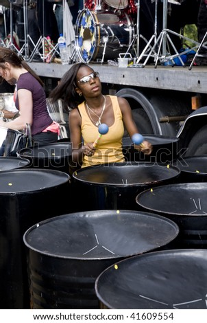 LONDON – AUGUST 29: Steel-drummers from the CIS Band Trust play steel drum at the Notting Hill Panorama Championships on August 29, 2009 in Hyde Park, London, England.