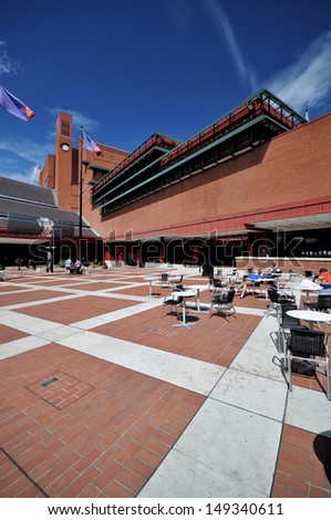 LONDON - AUGUST 4. The British Library holds 150 million books, manuscripts, philatelic and cartographic items, music scores and recordings. The landscaped concourse on August 4, 2013, in London, UK - stock photo