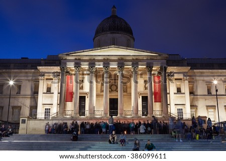 LONDON - AUGUST 10: The National Gallery at Trafalgar Square in London in the evening, tourists by on August 10, 2015 in London, UK. The gallery hosts a collection of over 2300 paintings. - stock photo