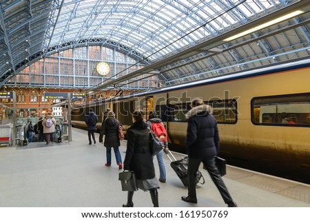 LONDON - AUGUST 4. The restored 1868 south-east facade of St Pancras International railway station and hotel, the redeveloped terminus for Eurostar services to Europe; August 4, 2013, in London, UK. - stock photo