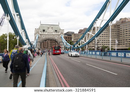 LONDON - 2015 AUGUST 5 : There is heavy traffic everyday in London.  Thousands cars, taxis, buses and pedestrians crossing River Thames on Tower Bridge.