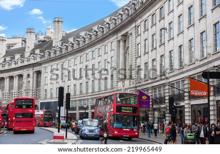 LONDON -AUGUST 16:Typical double decker bus in Regent street on August 16, 2014 in London. Regent Street is one of the major shopping streets in Europe, well known to tourists and Londoners alike.   - stock photo