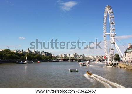 LONDON - AUGUST 18 : View of The London Eye on August 18, 2010 in London, England. A famous tourist attraction over river Thames in the capital city London. - stock photo