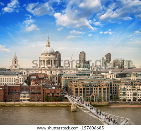 London. Beautiful aerial view of Millennium Bridge and St Paul Cathedral at sunset. - stock photo