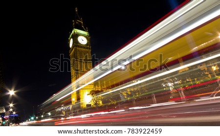 London Big ben and the light trail of a london bus. Houses of Parliament in the night with a lot of beatuiful lights in London, United Kingdom
