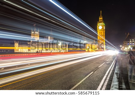 London Big Ben and traffic on Westminster Bridge in a beautiful summer night, London, England, United Kingdom