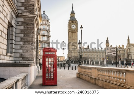 London - Big Ben tower and a red phone booth