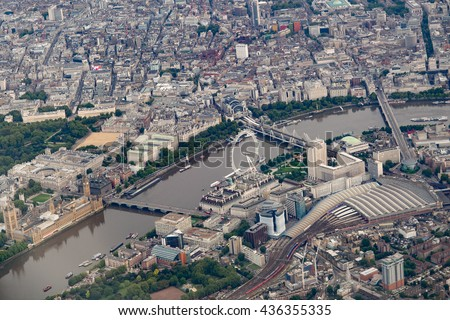 London bird's eye view. Aerial view of River Thames, Big Ben, London Eye, and Palace of Westminster in London, England. - stock photo