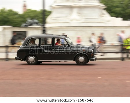 London black taxi in motion - stock photo