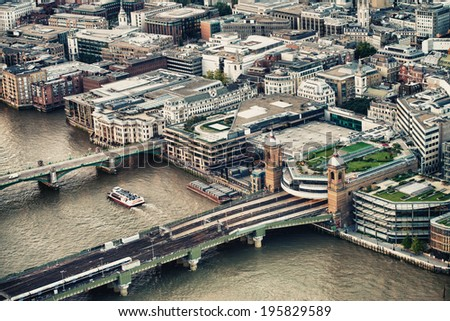 London buildings along river Thames, aerial view on a beautiful day. - stock photo