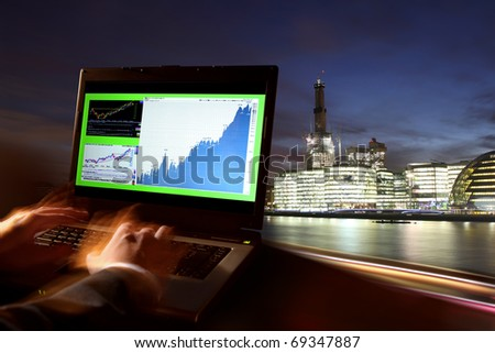 London, business office, man with laptop, London, UK - stock photo