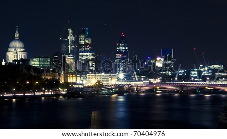 London by night. St Paul's Cathedral and financial district, Blackfriars Bridge - stock photo
