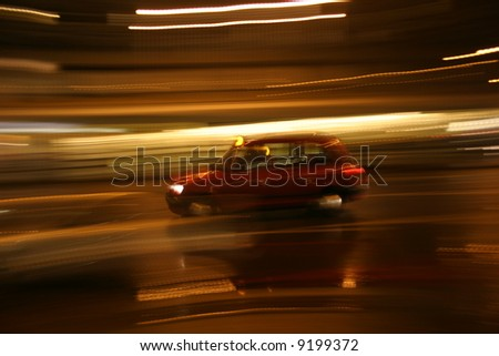 London Cab moving at speed -  motion blur - panning shot with light trails - stock photo