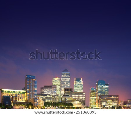 London, Canary Wharf in night. Business background with space for text - stock photo
