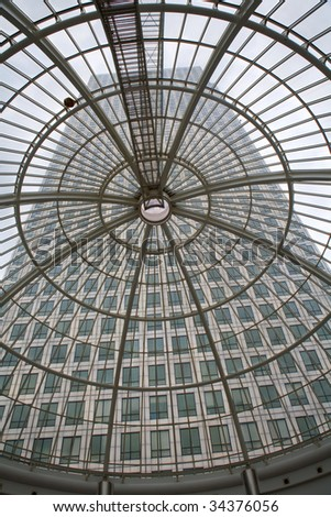 London -  Canary Wharf Tower and glass roof - stock photo