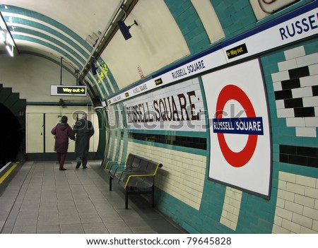 LONDON - CIRCA 2011: Commuters exit the Russell Square Tube Station circa 2011 in London. On July 7, 2005 a bomb exploded in a train en route to this station. - stock photo
