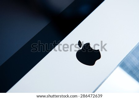 "LONDON - CIRCA 2014: Detail of the new Apple iMac Retina 5K computer with its logo and Retina screen on foreground. Main feature is a ""Retina 5K"" display at a resolution of 5120 x 2880 pixels - stock photo"