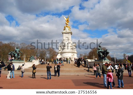 LONDON – CIRCA MARCH 2009 : Tourists visit Queen Victoria Memorial, circa March 2009 in London, England. The memorial was built by sculptor Sir Thomas Brock in 1911. - stock photo