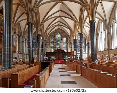 LONDON - CIRCA 2013:  The medieval Temple Church is one of the oldest in London.  Originally used by the Knights Templar, it is now surrounded by law offices.         - stock photo