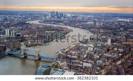 London City Evening Sunset. Looking East, River Thames, Tower Bridge, Canary Wharf. - stock photo