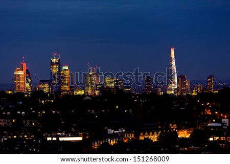 London City Skyline at Night, from Alexandra Palace. England, UK - stock photo