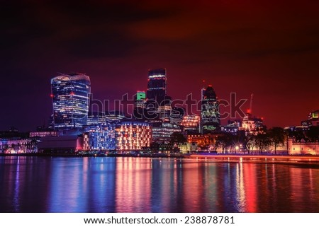 London city skyline from the River Thames by night