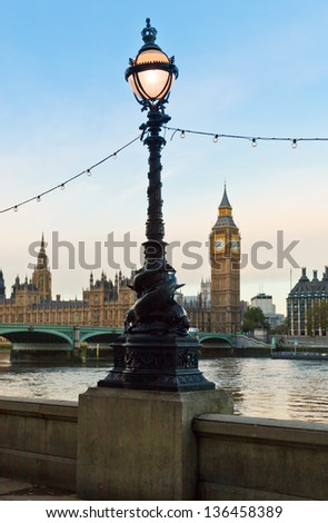 London cityscape with street lamp and Palace of Westminster in background - stock photo
