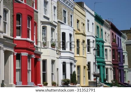 London, coloured houses in Portobello road - stock photo