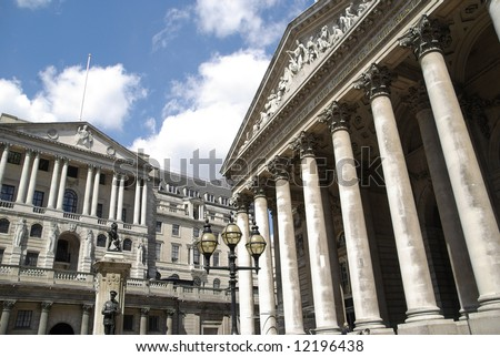 London Columns of the Royal Exchange shopping complex with Bank Of England building beyond - stock photo