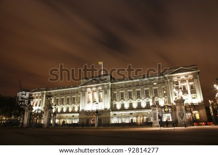 LONDON - DEC 13: Buckingham Palace's principal facade, constructed by Edward Blore and completed in 1850, on December 13, 2011 in London, UK. Palace became the principal royal residence in 1837 - stock photo