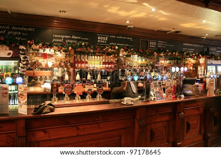 LONDON - DEC 1: Interior of pub, for drinking and socializing, focal point of the community, on Dec 1, 2010, London, UK. Pub business, now about 53,500 pubs in the UK, has been declining every year - stock photo