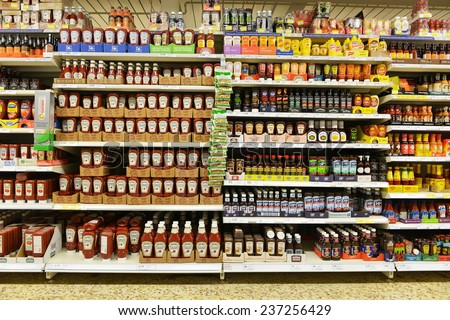 LONDON - DEC 12: Shelf view of a Tesco supermarket store on Dec 12, 2014 in London, UK. Britain's Tesco is the world's third largest retailer after America's Walmart and France's Carrefour. - stock photo
