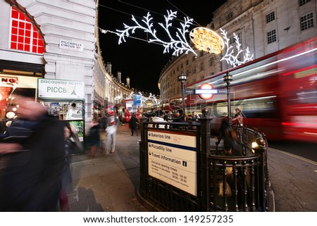 LONDON - DEC 3: View of Piccadilly Circus, road junction, built in 1819, links to West End, Regent Street, Haymarket, Leicester Square, with christmas decorationon Dec 3, 2012 in London, UK.  - stock photo