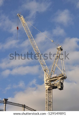 LONDON - DECEMBER 3, 2016. A building construction crane on a redevelopment site in the King's Cross area of London, UK.