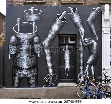 LONDON - DECEMBER 28, 2014. A wall painting in Hanbury Street at Shoreditch in the Borough of Tower Hamlets, an area renown for its street art in east London, UK. - stock photo