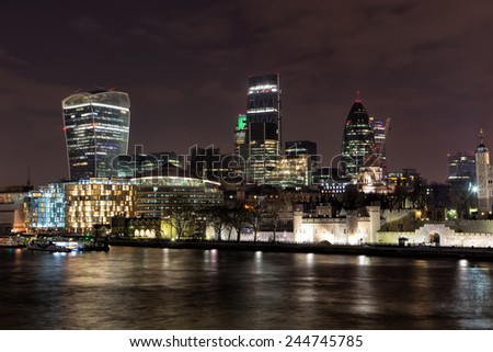 LONDON - DECEMBER 31: City of London at night on December 31, 2015. The City is a tiny part of the metropolis of the London region. It holds city status in its own right. - stock photo