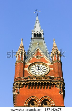 LONDON - DECEMBER 20 : Old fashioned clock at St Pancras International Station in London on December 20, 2007 - stock photo