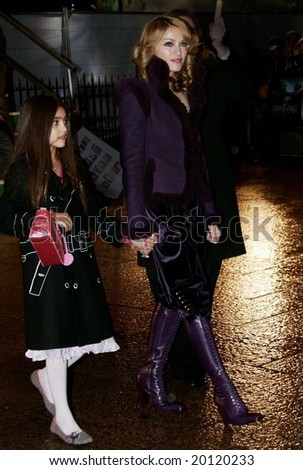LONDON - DECEMBER 6: Singer Madonna and daughter Lourdes attends the red carpet premiere of Harry Potter  December 6, 2005 in London, England. - stock photo