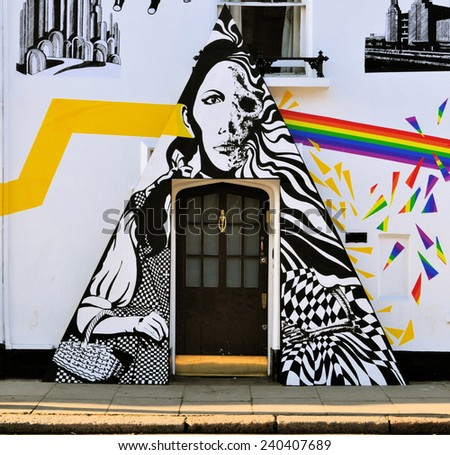 LONDON - DECEMBER 6. Street art at Chelsea Arts Club doorway based on Pink Floyd's The Dark side of the Moon album and synchronicity with the film The Wizard of Oz; December 6, 2014; Chelsea, London. - stock photo