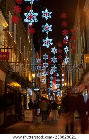 LONDON - DECEMBER 16th 2014: Christmas lights on Carnaby Street, London,UK. This popular area with many shops and restaurants gets decorated with Christmas lights in December.