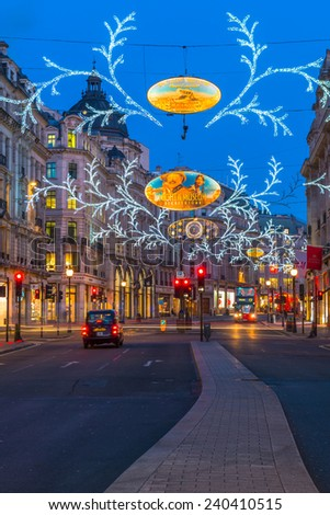 LONDON - DECEMBER 29th 2014: Christmas lights on Regent Street, London, UK. The Christmas lights attract thousands of shoppers during the festive season and are a major tourist attraction in London