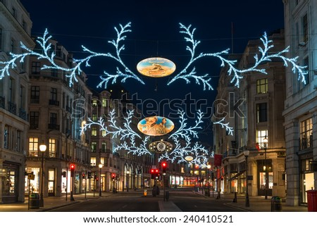 LONDON - DECEMBER 29th 2014: Christmas lights on Regent Street, London, UK. The Christmas lights attract thousands of shoppers during the festive season and are a major tourist attraction in London - stock photo