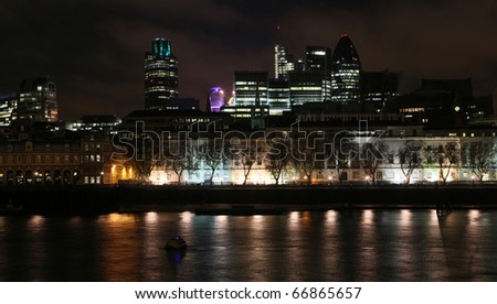 London downtown at night captured from the other bank of Thames - stock photo