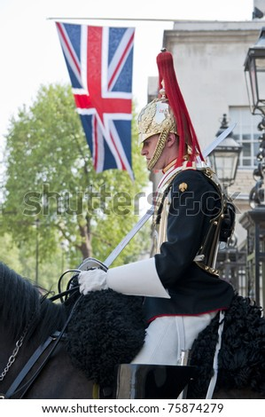London, England - April 24, 2011: A mounted horse guard stands guards outside the horse guards parade in London.