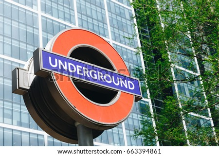 London, England - April 3, 2017: Close up of a traditional station sign for the London Underground transportation systems in London. The sign was first used in 1908.