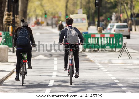 London, England - April 30, 2016: Cyclists using the new East-west Cycle Superhighway, flagship in mayor Boris Johnson's transport policy, on the Embankment in central London.