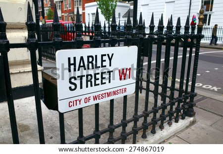 London, England - April 30, 2015: Harley Street place sign on iron railings in London, England. Harley Street has a global reputation for provision of private medical and health services  - stock photo