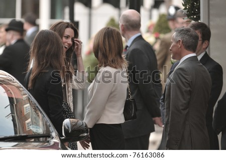 LONDON, ENGLAND - APRIL 28: Kate Middleton (far left, smiling) arrives at the Goring Hotel on the evening before her wedding to Prince William on April 28, 2011 in London England. - stock photo