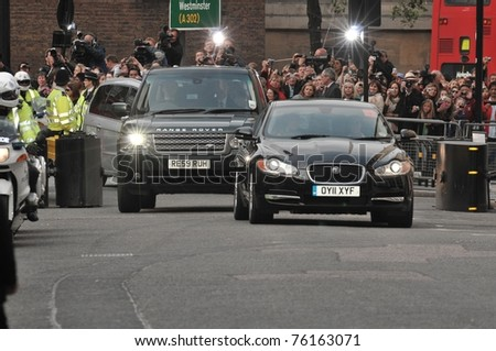 LONDON, ENGLAND - APRIL 28: Kate Middleton's motorcade arrives at the Goring Hotel on the evening before her wedding to Prince William on April 28, 2011 in London England. - stock photo