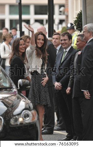 LONDON, ENGLAND - APRIL 28: Kate Middleton waves to onlookers as she arrives at the Goring Hotel on the evening before her wedding to Prince William on April 28, 2011 in London England. - stock photo